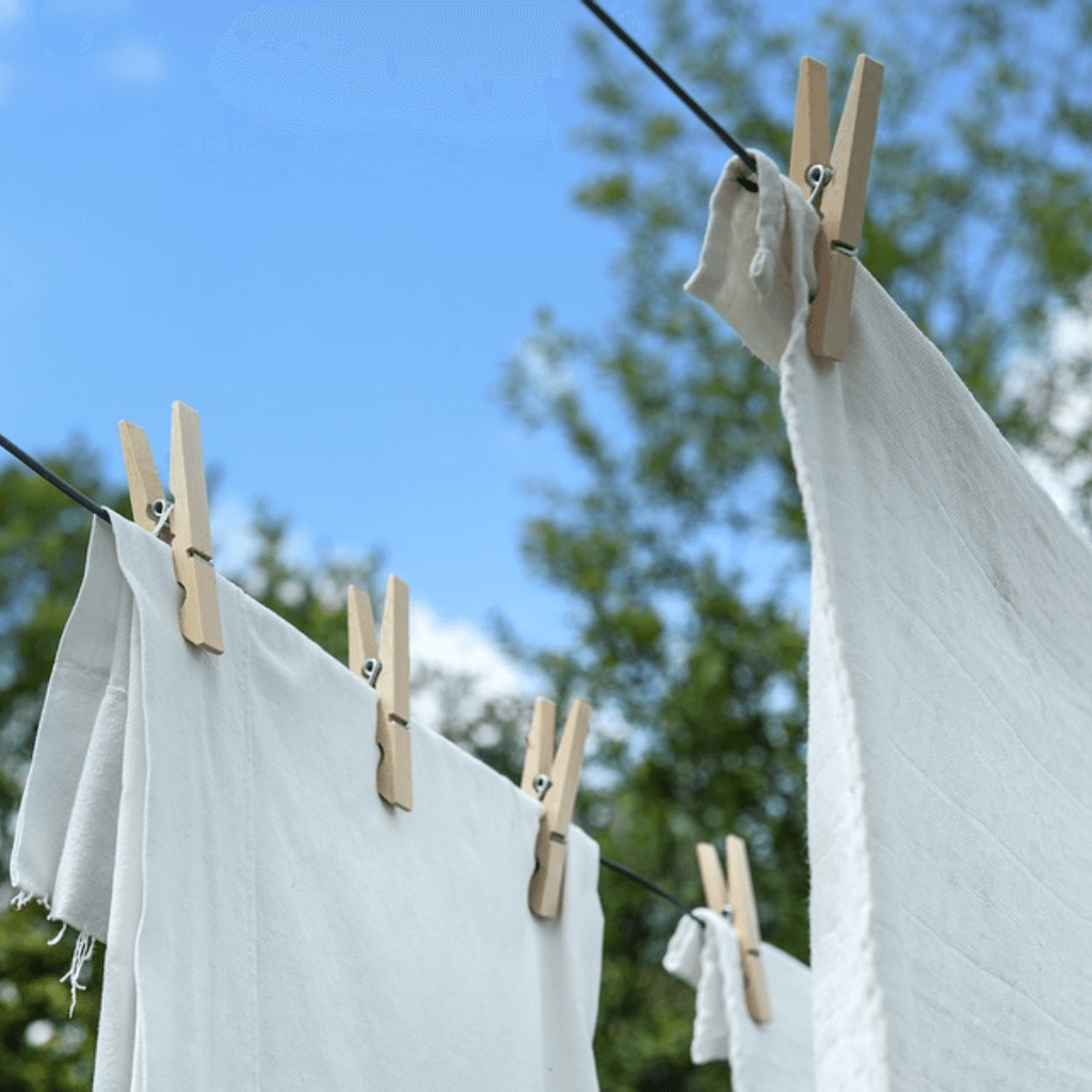 Clothes drying outside on a line.